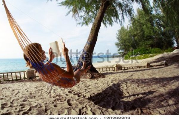 stock-photo-young-woman-reading-a-book-lying-in-a-hammock-on-tropical-sandy-beach-120398809